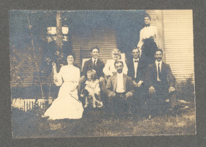 "Anderson Family of William H. Anderson, Sr. (then deceased) at Brooksbys Point, Severn Cross Roads, Millersville, MD (where they were then living circa 1900 to 1910 or thereabouts) includes (not necessarily in order Left to Right, 1st Row: Daughter Ida M. Anderson (later married C. Milton Duvall, of Crownsville, Maryland); their young cousin, Fannie (Frances) Meade (later Mrs. Benjamin Williams and, still later, Mrs. Edwin Schad, of Waterbury, Maryland; Son Albert R. Anderson, Sr.; Seated: Bachelor son Lemuel Orme Anderson (the ""Knight of Severn Cross Roads"" in local jousting tournaments); young Stella Rice (a neighbor); Bachelor son William H. Anderson, Jr.; and Son Marvin Wesley Anderson. Standing in the rear is their widowed mother: Sarah Elizabeth (""Aunt Betty"" to her numerous nieces and nephews) (Scrivener) Anderson."