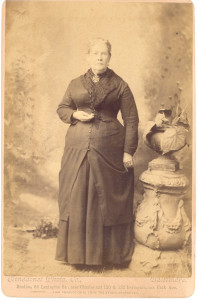 This photograph is identified on the back as the second Mrs. Edward E. Anderson and is believed to be of Caroline (Spears) Anderson, who was the (first and only?) wife of Edward E. Anderson (II) (son of Thomas and Eleanor (Warfield) Anderson, and, therefore, part of the William (III) Anderson line, there are other groups of photographs extant showing these and other branches . And it is not clear that the lady shown is really Caroline (Spears) Anderson, because there were more than one Edward Edwards Andersons junior to Edward Edwards Anderson, Sr., in the total family. This lady might have been the second wife of any of such juniors. For example, she might have been Mary (Evans) Anderson, second wife of Edward Edwards Anderson (son of William and Sarah Jane (Waters) Anderson. See page 35 of Mrs. DuLaney's Anderson genealogy