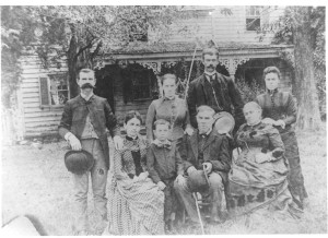 The Andersons of Woodwardville standing in front of the front porch of the Providence Plantation Home circa 1890 to 1900, soon before the death of Hannah (Moler) Anderson (Mrs. William Thomas Anderson, Sr.), Mrs. DuLaney's grandmother. This photograph is on the front cover of Mrs. DuLaney's In Dogwood Blossoming Times...., and those shown were her parents and her aunt s and uncles in her immediate family. They have all been identified by name in that booklet, as corrected in a subsequent annual newsletter of The Grassland Foundation, Inc. The home and most of the farm were sold following the death of Mrs. William Thomas Anderson, Sr., soon after 1900. The home survived in other ownership(s) until the post-World War II period.