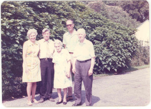 "A Group Photograph Taken a Number of Years Ago at Frederick, MD, showing Doris (Hemp) Gaither, her husband, Francis (""Frank"") Gaither, Jr., Ruth (Gittinger) Gaither (Mrs. Francis Gaither, Sr.), and her husband, Francis Gaither, Sr. The two ""Frank Gaithers"" were the son and grandson, respectively, of Matilda (""Tillie"") (Anderson) Gaither (Mrs. Samuel R. Gaither). Matilda Anderson and one of her brothers, Isaac Cord (II) Anderson, Sr., were siblings who met and married siblings at and near Marriottsville, Howard County, Maryland, whom they had met as a consequence of visiting the Marriottsville home and farm of the senior Isaac Cord (I) Anderson, the wealthy bachelor who lived and resided at Marriottsville, to which he brought his young cousin, the younger namesake, Isaac Cord (II) Anderson, Sr., to help raise him. DE:82, 106-107,108."