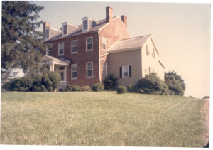 Two photographs of Halls Grove home off the West side of Davidsonville Road (Md. Rte. No. 424) near Rutland at Gambrills, Anne Arundel County, Maryland, the last brick home of this Federal-style type that was built in that area in the 1850s by Absolom Anderson Hall and Julia (Beard) Hall, his wife. Ab Hall was a son of Ann Duckett (Anderson) Hall and Thomas Hall, her husband.