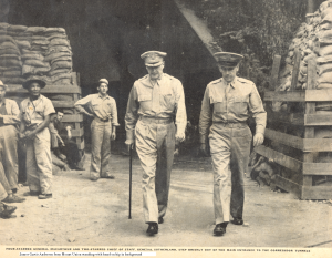 James Curtis Anderson is standing in the background with hand on hip. He was later captured and died in a Japanese prisoner of war camp in Mukden, China.