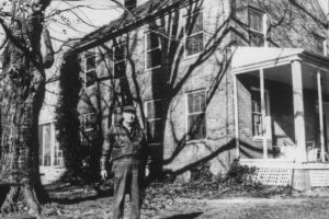 Captain John Bowie, Jr. (Grandson of William Anderson, of Grassland, the builder), United States Coast and Geodetic Survey, Retired, standing in front of the Grassland home a few years before his death in 1986