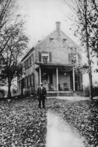 Anne Arundel County, Maryland Sheriff John Bowie (father of Captain Bowie, above), standing near the then front porch of the Grassland home at a time and on a date which was after the completion of changes and additions which had been made to the home toward the end of World War II.