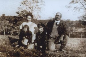 From left to right: Front Row: John Bowie, Jr., and his sister, Susannah Frances Bowie (children); Back Row: Ethel Bowie, Sheriff John Bowie.
