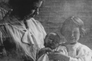 Mrs. Ethel (Cooke) Bowie (Mrs. John Bowie) of Grassland. She was the Sheriff's wife and the mother of his children. Here she is depicted with two of her infant children, including her daughter, Susannah Frances (who later became Mrs. C. Elliott Baldwin). Mrs. Bowie was tragically killed during World War II at Laurel, Maryland, when, as a pedestrian walking, she was struck and killed by a motor vehicle.